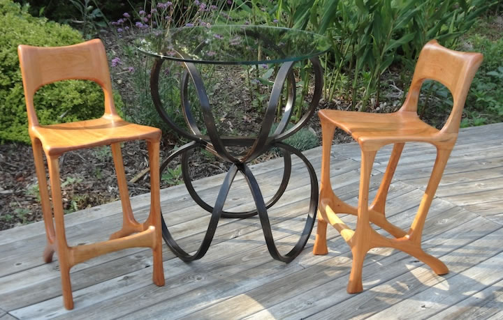 Trefoil Cocktail table with two Ordinary Chairs